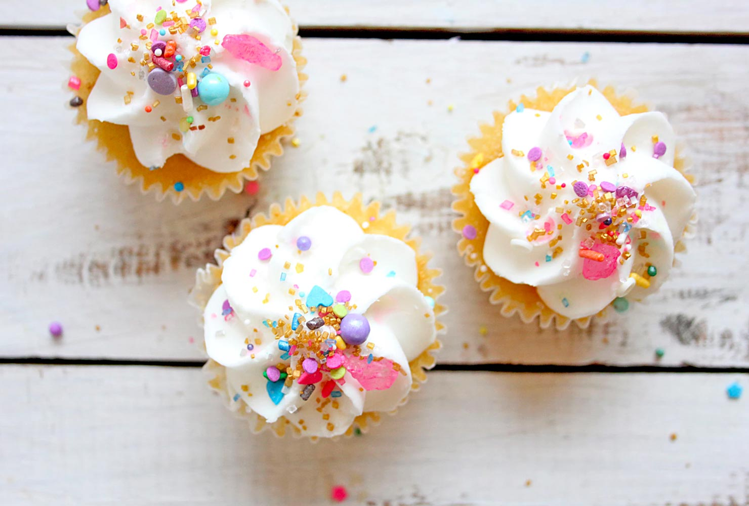 Cupcakes with colorful sprinkles.