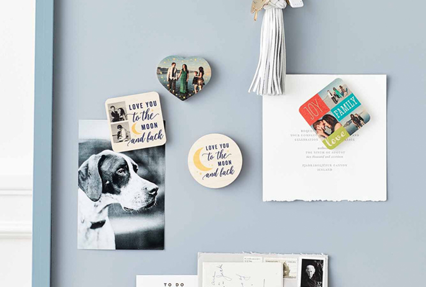 Photo magnet set hanging on wall.