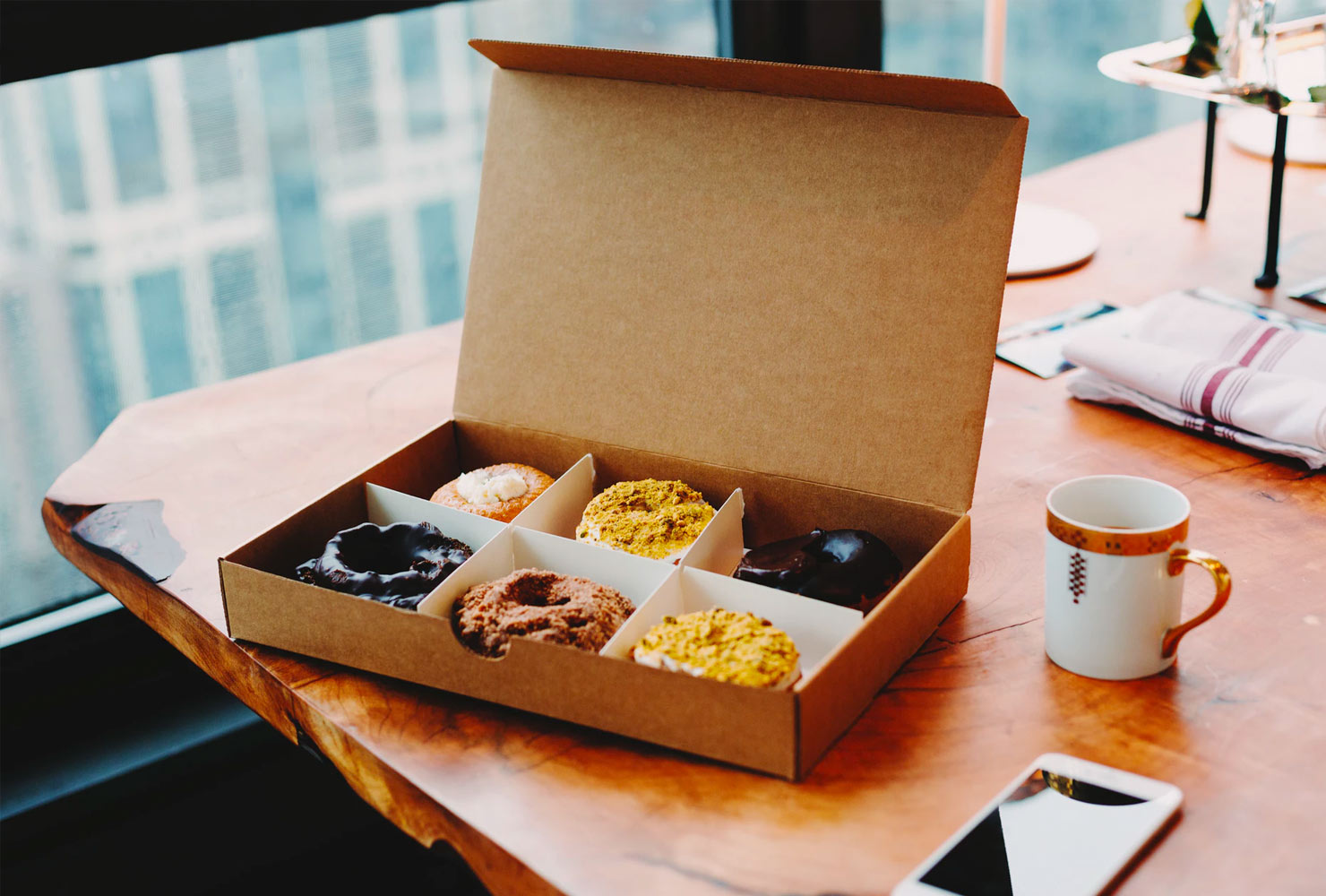 Box of donuts and coffee.